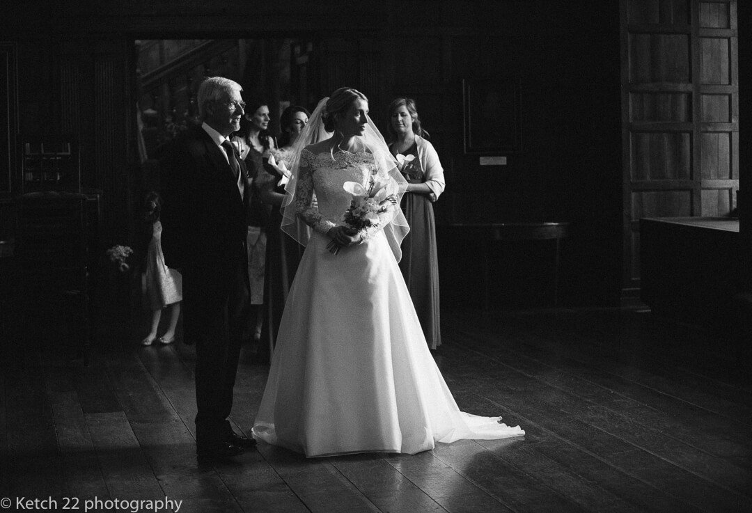 Moody black and white photo of bride just before wedding ceremony