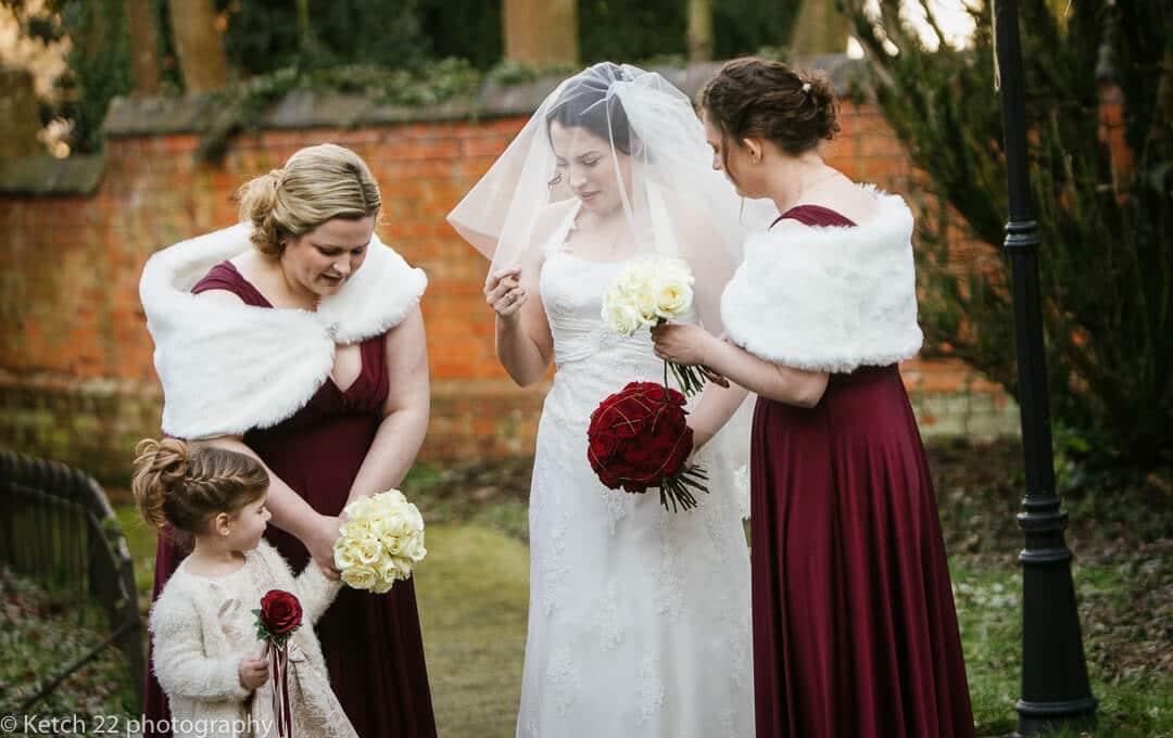 Bride adjusting her wedding veil before ceremony