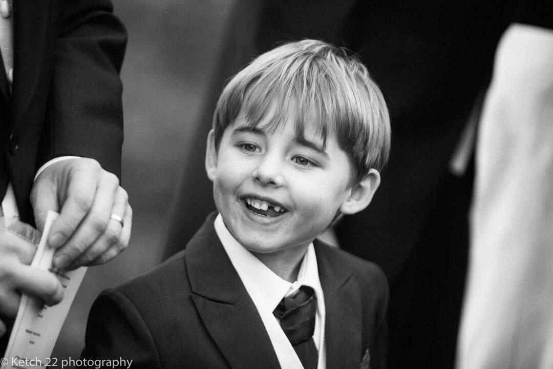 Page boy smiling at reportage wedding