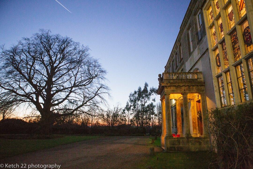 Night time exterior view of Elmore Court wedding venue