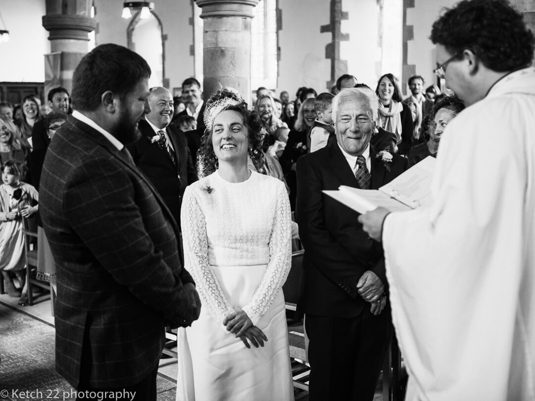 Bride looking at groom for first time at wedding ceremony