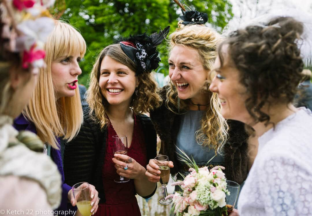 Wedding guests laughing with bride