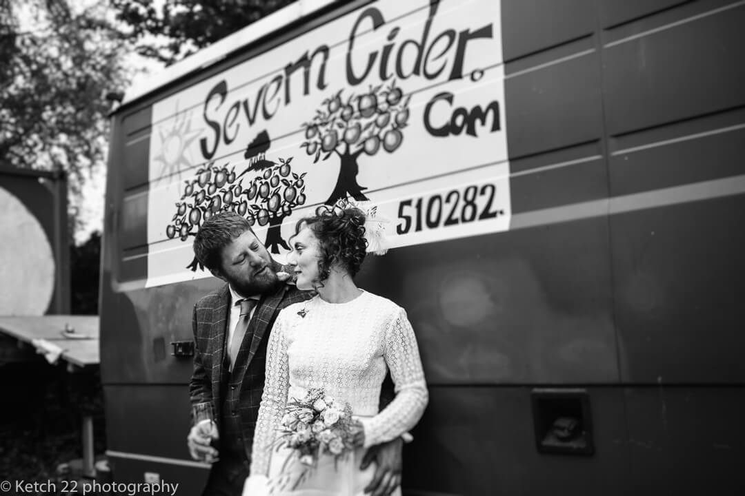 Portrait of bride and groom in front of Severn Cider van in Gloucestershire