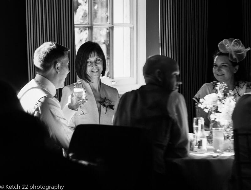 Guests enjoying wedding breakfast at The Swan at Bibury Gloucestershire