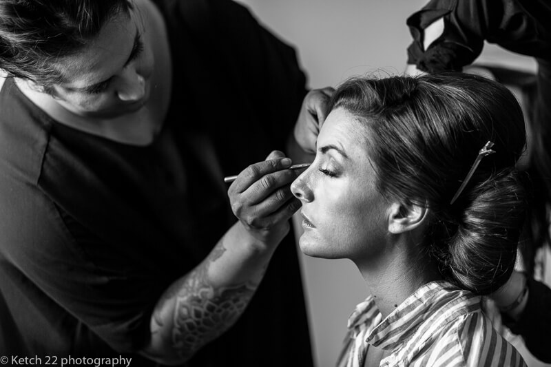 Bride having makeup done at Dorset summer wedding