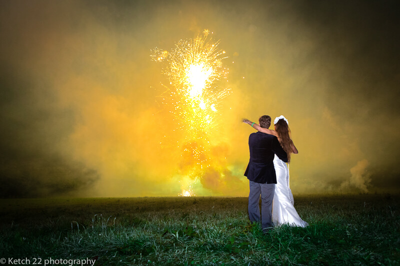 Bride and groom watching fireworks at Dorset summer wedding