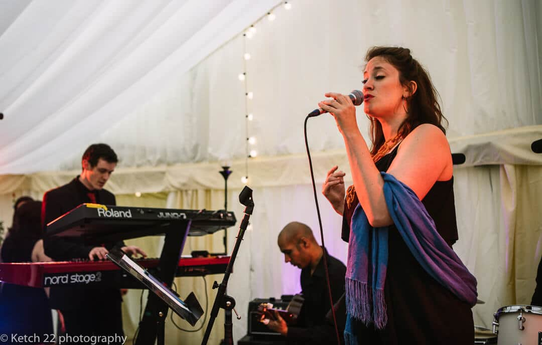 Singer in wedding band performing on stage