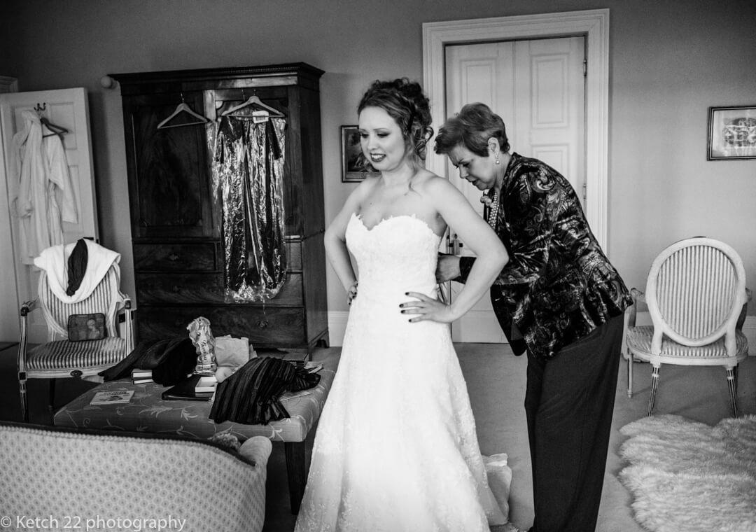 Bride at final preparations at country house wedding