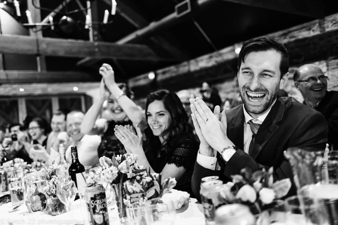 Storytelling wedding image of guests laughing at the speeches