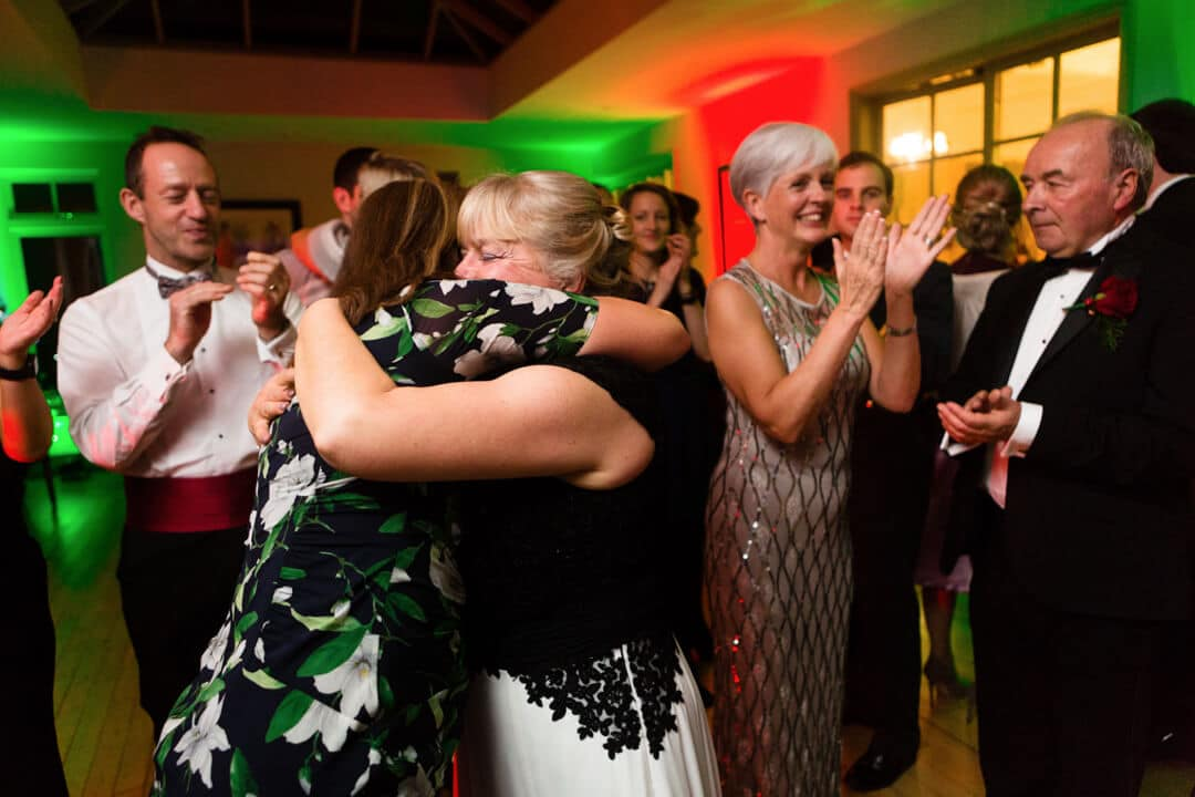 Guests hugging at Wedding reception
