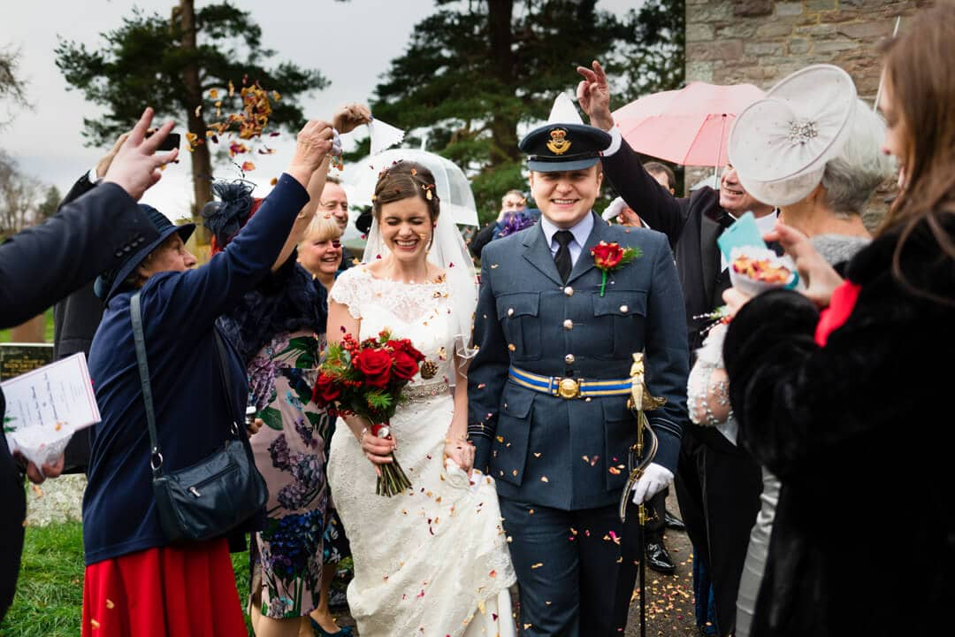 Bride and groom get showered with confetti at Winter Welsh Wedding