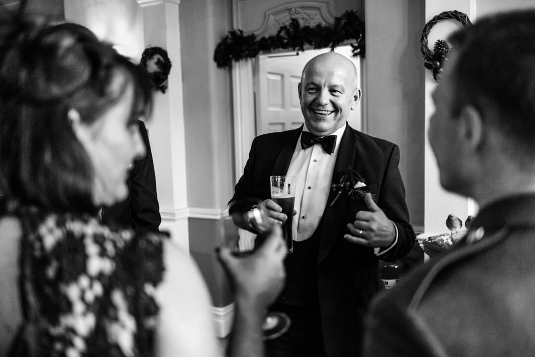 Father of the groom chatting with wedding guests