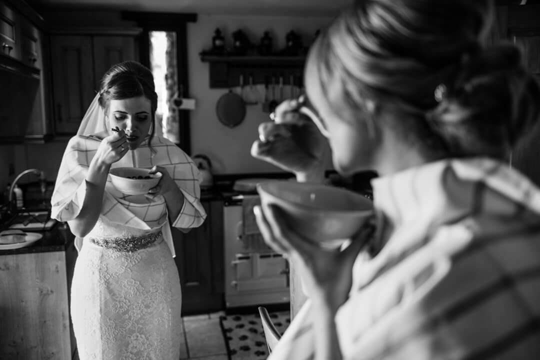 Bride eating breakfast at wedding preparations