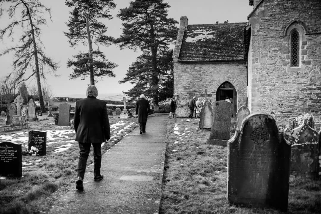 Guests arriving at church just before wedding