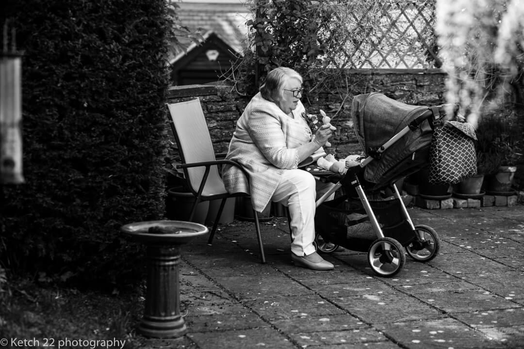 Grandma looking after baby at Reportage wedding