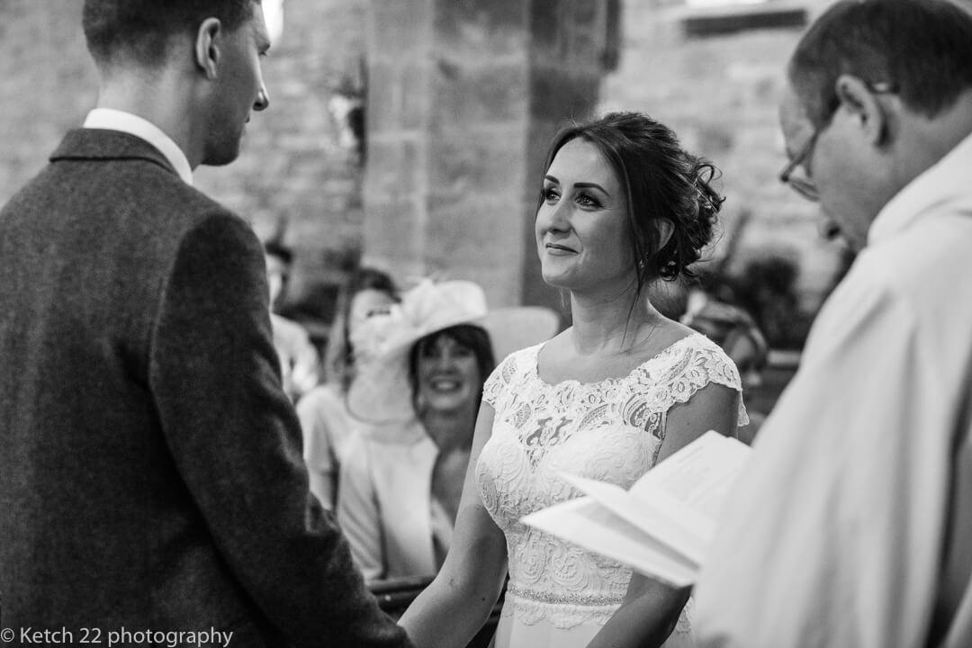 Bride looking into grooms eyes at church wedding ceremony