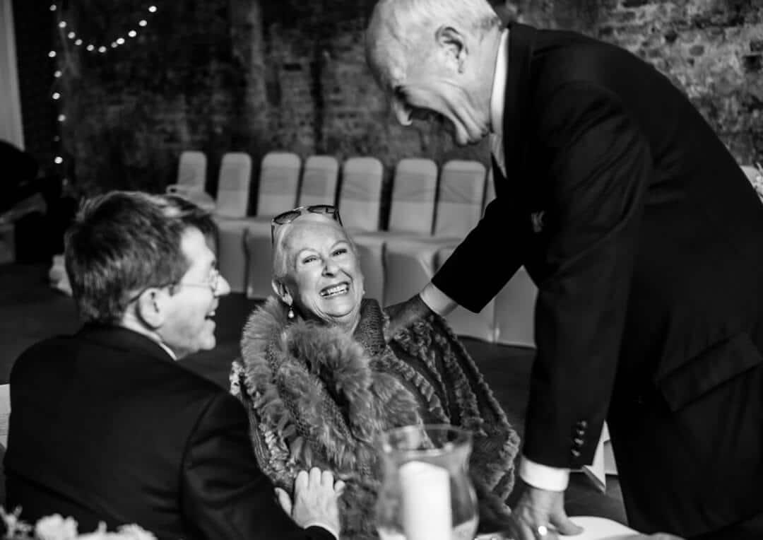 Grandma laughing at wedding reception