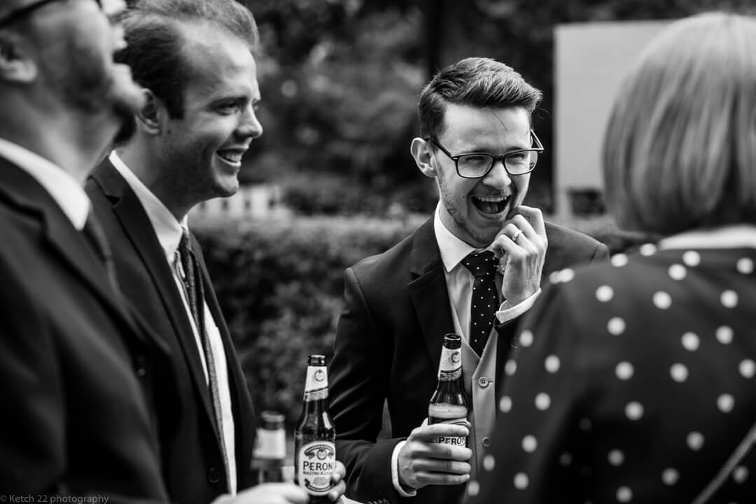 Best man laughing with beer at No 38 Wedding Cheltenham