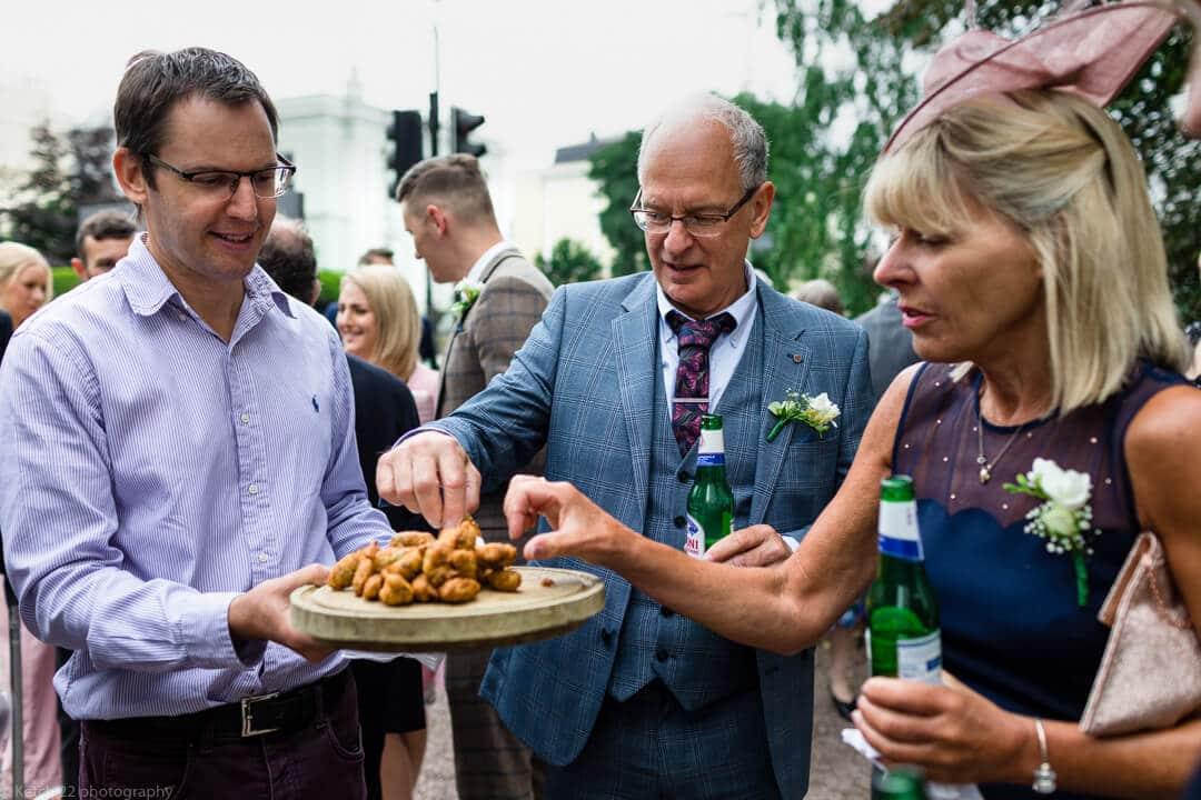 Wedding guests enjoying canapes