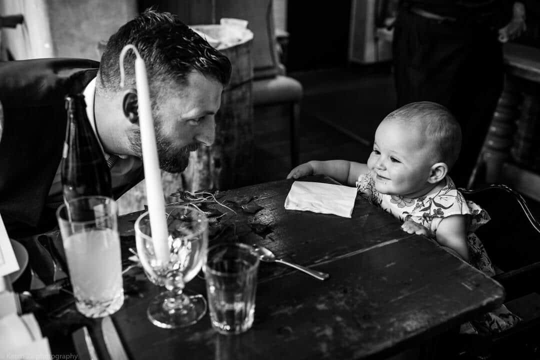 Dad and baby at wedding