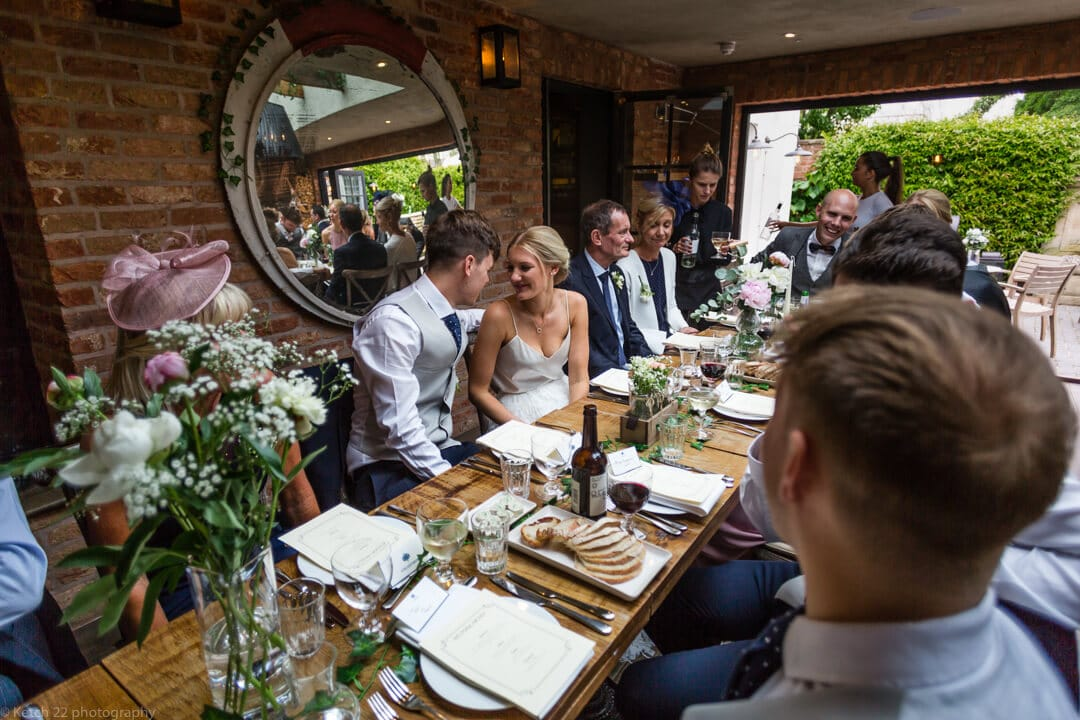 Bride and groom in dinning room