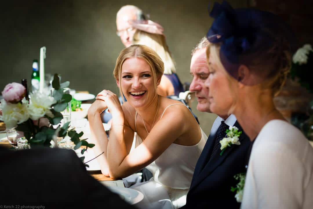 Bride laughing at wedding breakfast