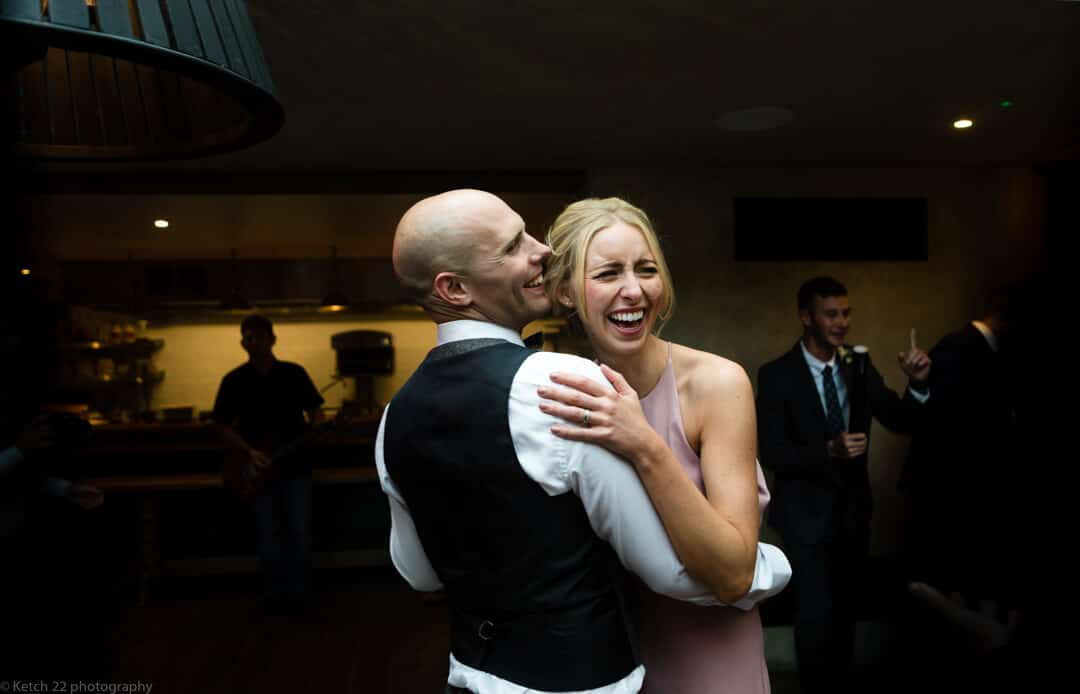 Bridesmaid dancing and laughing