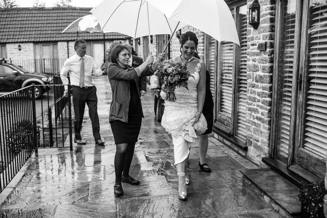 Bride arrives at Wedding on rainy day