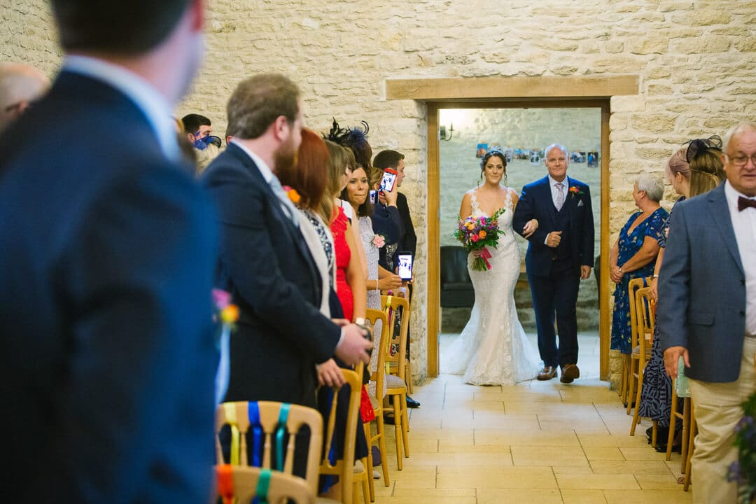 Bride and father enter wedding ceremony