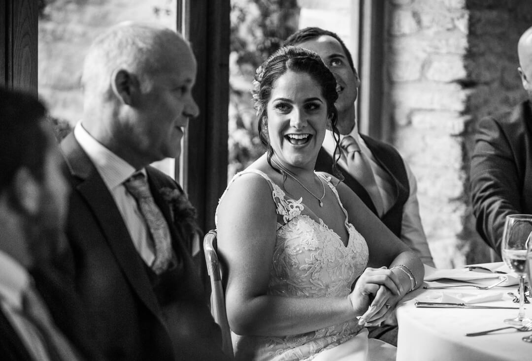 Bride looking at father during wedding speeches