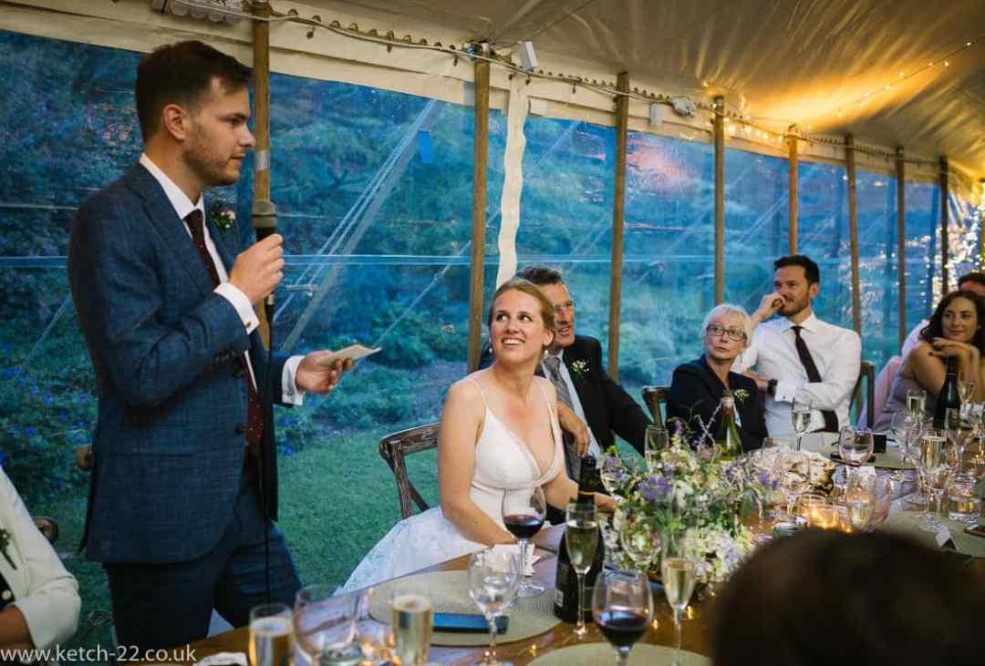 Documentary wedding photo of grooms speech