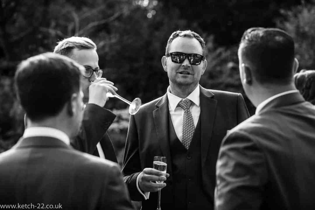 Wedding guest with shades
