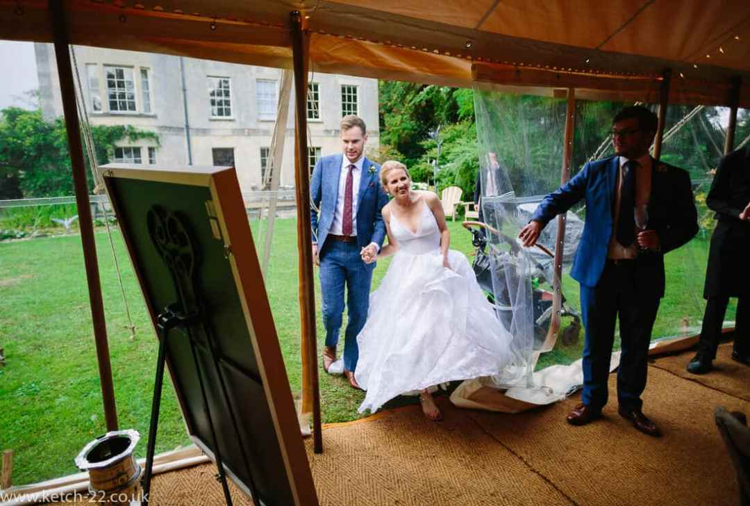 Bride and groom enter marquee
