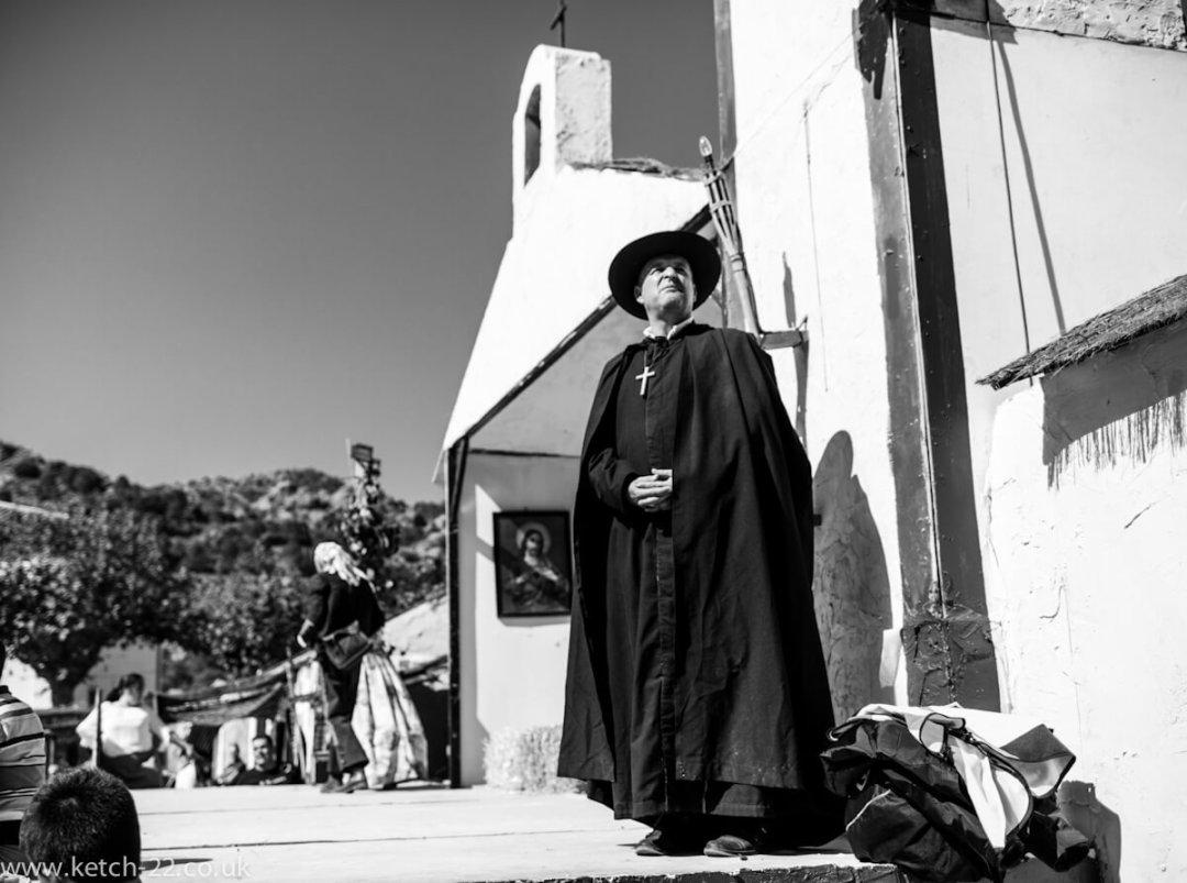 Man dressed as Priest in black and white at Grazalema fiesta