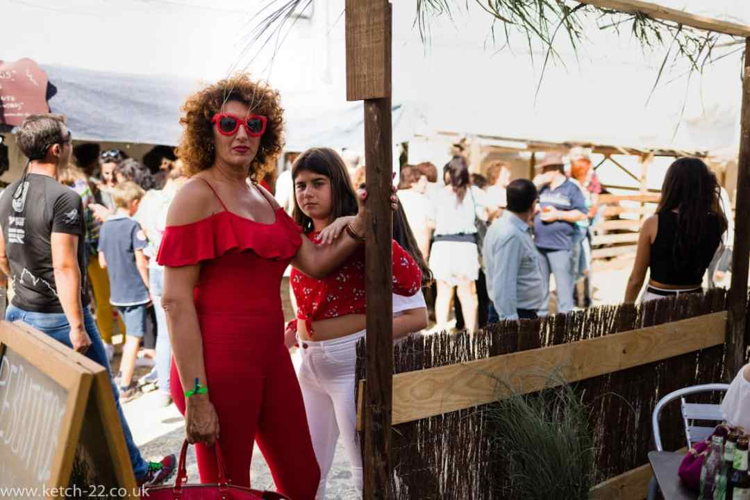 Eccentric Spanish woman wearing red with her daughter at Grazalema fiesta