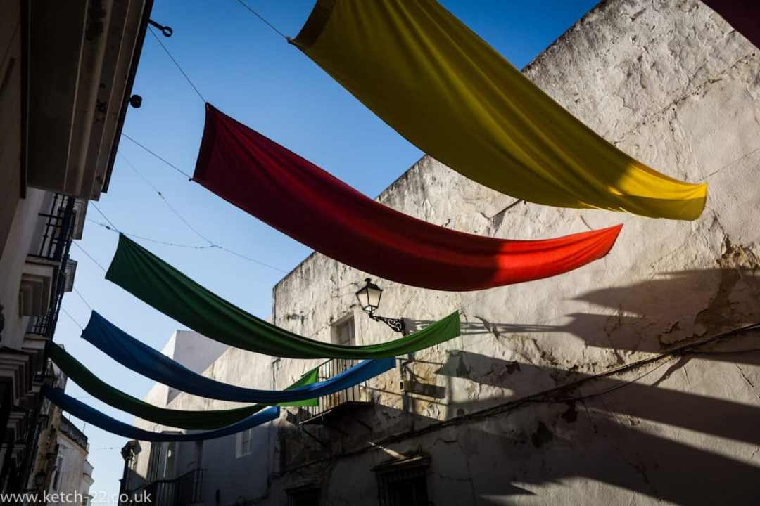 Colourful banners fly above the street in Arcos de la Frontera