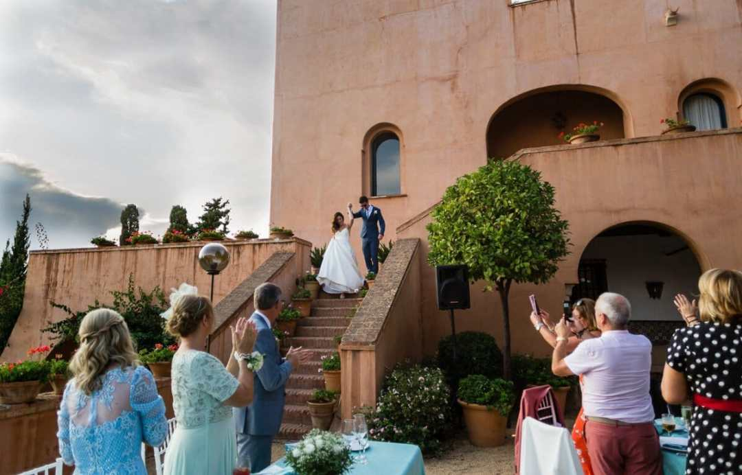 Bride and groom making an entrance to Wedding breakfast