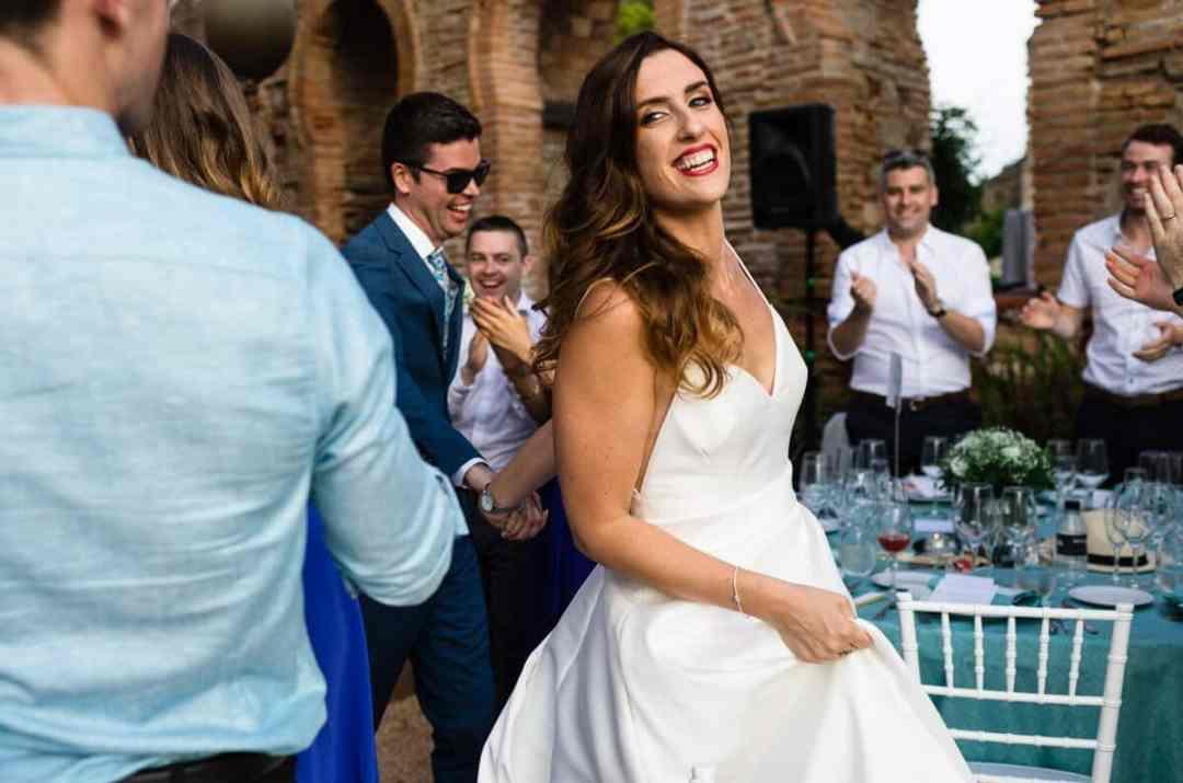 Bride walking through cheering wedding guests