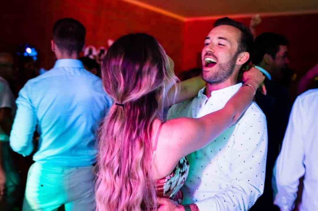 Guests dancing at wedding party