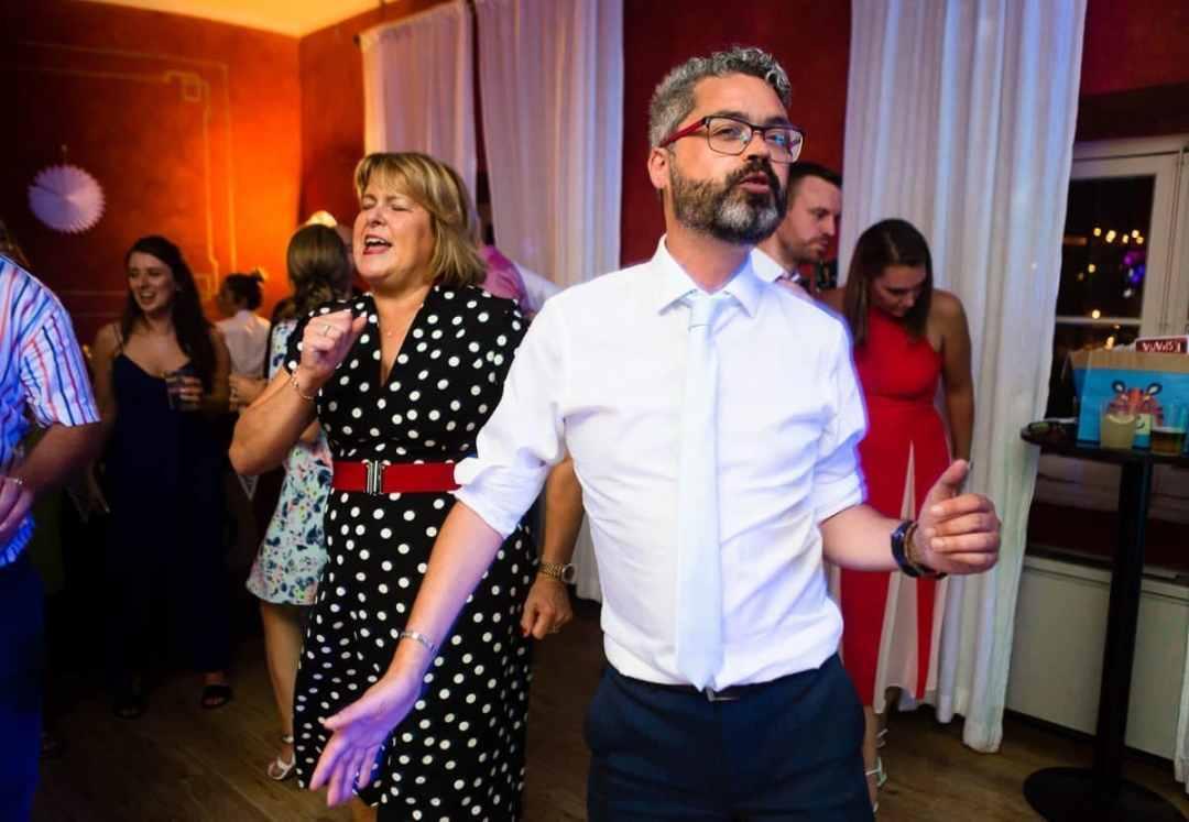Best man dancing at wedding reception