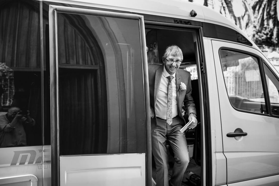 Father of bride arriving in mini bus to Wedding ceremony