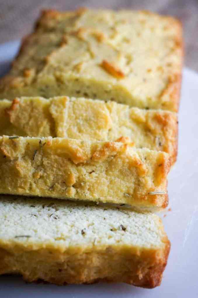 large slices of coconut flour bread on a cutting board