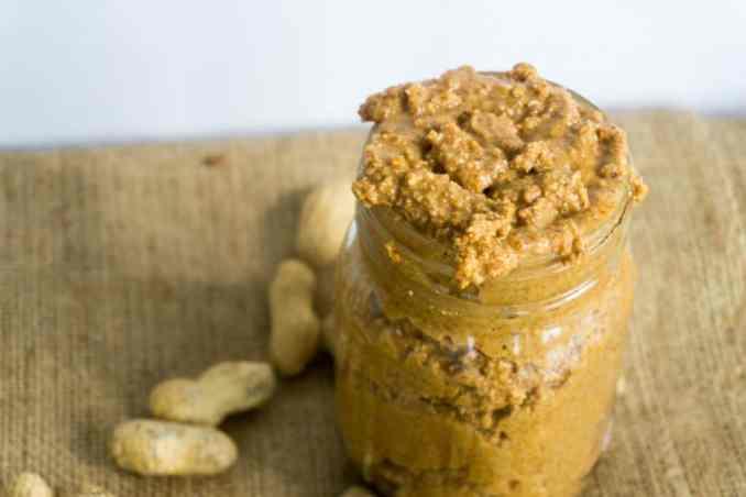 freshly ground peanuts in a mason jar