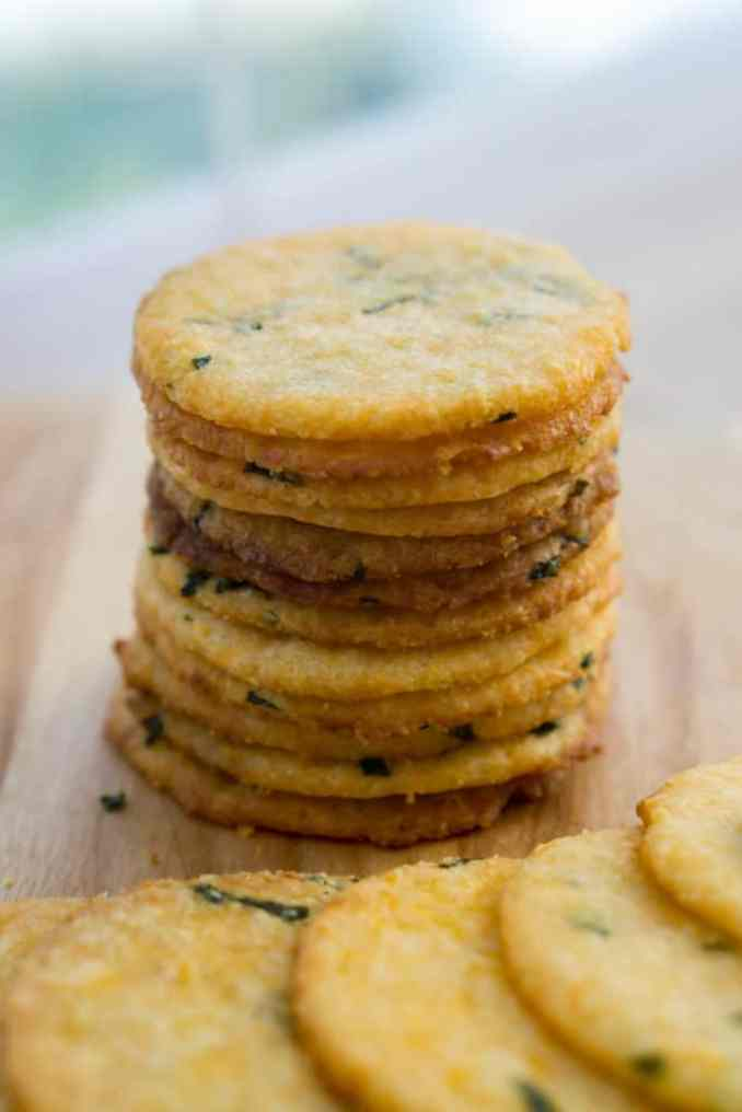 stack of ten low carb cheese crackers with herbs baked in