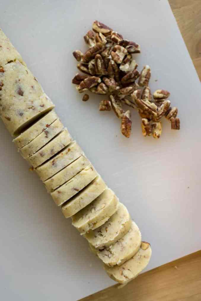 Cookie dough next to chopped pecans