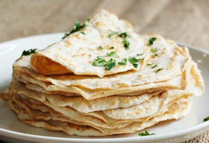 tortillas stacked on a kitchen table