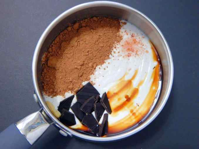 coconut milk, chocolate, vanilla, and salt in a silver pot