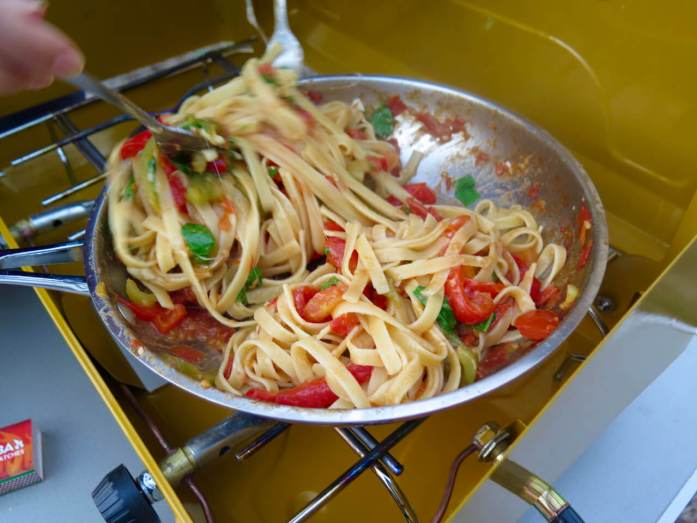 A pan of pasta cooking on our camp stove that we carry while traveling in a van in New Zealand. ©KettiWilhelm2016