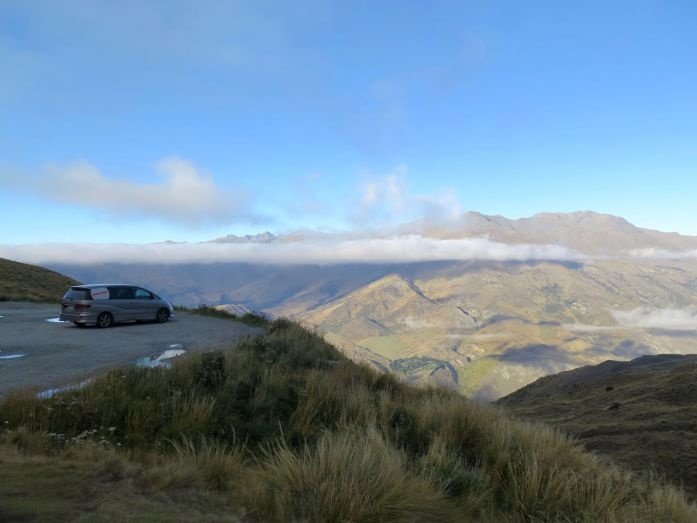 The Toyota Estima van we rented to travel New Zealand for months, parked overlooking the mountains. ©KettiWilhelm2016
