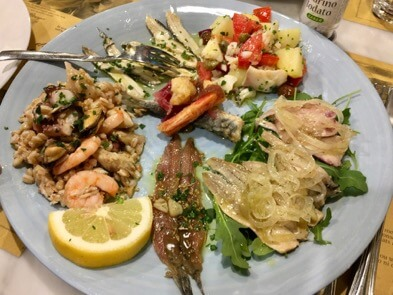 A sampler of Mediterranean seafood antipasti at a restaurant in Liguria, Italy. ©KettiWilhelm2017